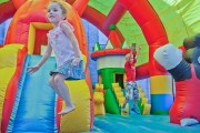 children playing on an inflatable playset